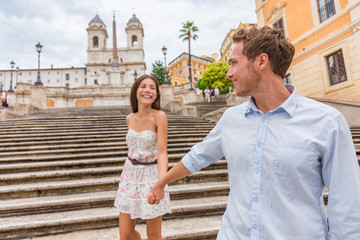 Deurstickers Rome Happy romantic couple holding hands on Spanish Steps in Rome, Italy. Joyful young interracial couple walking on the travel landmark tourist attraction on romance Europe holiday vacation.