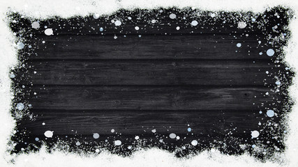 winter Background - Frame made of snow on wooden texture, top view with space for text