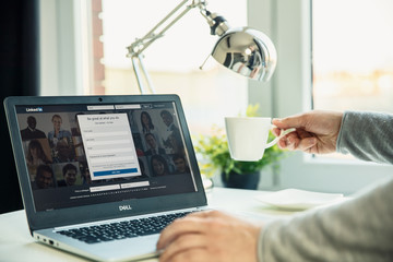 WROCLAW, POLAND - NOVEMBER 29th, 2018: Modern laptop on the desk in office with Linkedin website on the screen. LinkedIn is a business and employment-oriented service