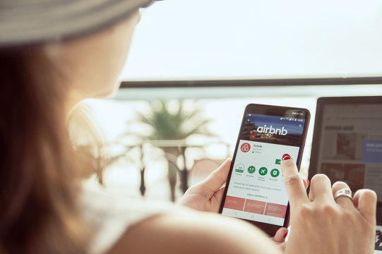 TROGIR, CROATIA  -  SEPTEMBER 13th, 2018: Woman is installing Airbnb application on Nokia smartphone. Airbnb is an online marketplace and hospitality service