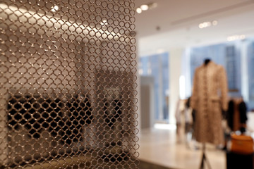 A mesh wall separates designer section at the Nordstrom flagship store during a media preview in New York
