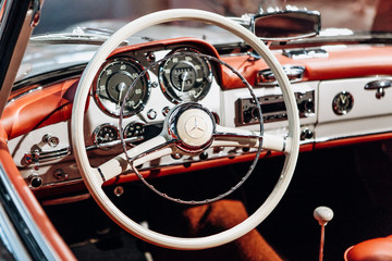 Berlin, August 29, 2018: Interior of the german classic vehicle Mercedes-Benz 190SL. Retro design car. Exhibition car in the official dealer center Mercedes-Benz in Berlin.