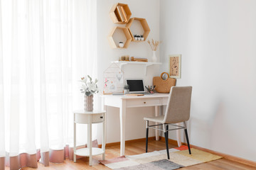 Comfortable workplace with mood board at home