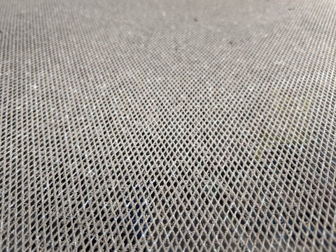 Small metal mesh close up, wire netting texture background