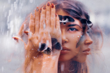 Keuken foto achterwand People beautiful young woman with butterfly. conceptual. double exposure