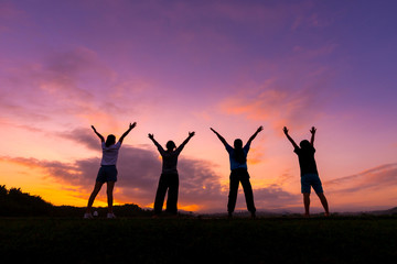 Group of healthy girl show hands with  sunset background.Healthy exercise lifestyle concept.