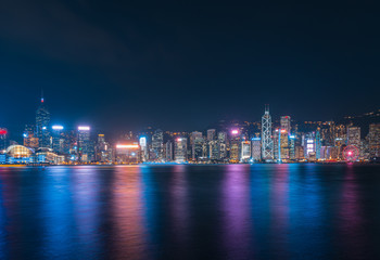 Wall Mural - Hong Kong cityscape at night. View From Victoria Harbour