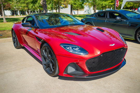 Front side view of a red Aston Martin DBS Superleggera sports car on October 19, 2019 in Westlake, Texas.