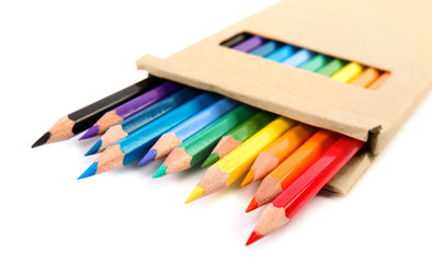 Box of color pencils on white background