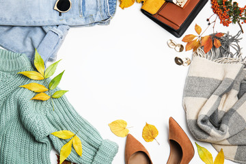 Fototapete - Warm clothes, autumn leaves and accessories on white background, top view. Space for text