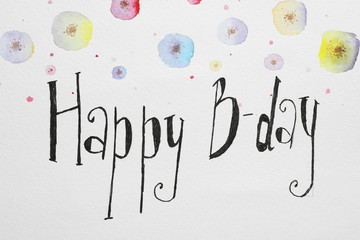 Words HAPPY BIRTHDAY and color flowers pictures on white paper, top view