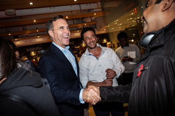Bill Morneau, Canada's Finance Minister and Liberal Party candidate for Parliament, greets supporters after being re-elected