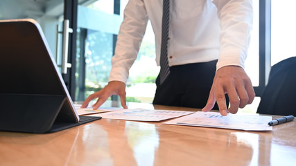 Businessman analysis and review document finance data.