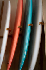 elegant surfboards leaning against each other even spacing muted colors