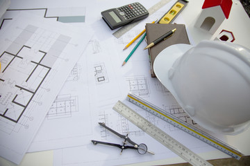 Desk of Architectural working project in construction site,With drawing equipment concept