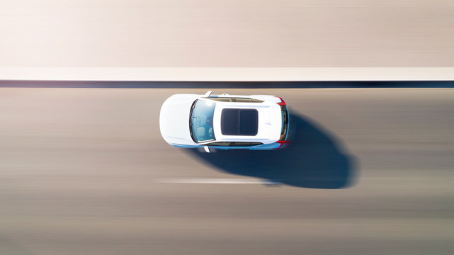 Aerial top down view of the white car moving fast