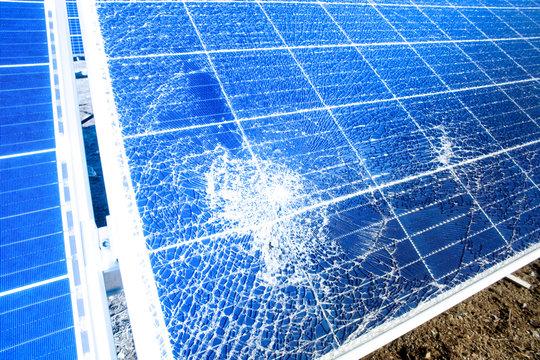 Broken destroyed cracked hole in solar panel