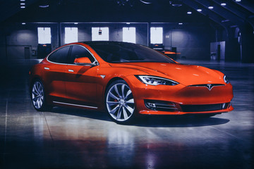 Berlin, August 29, 2018: Photo of the image of an electric vehicle Tesla at the Tesla motor show in Berlin. A modern electric car.