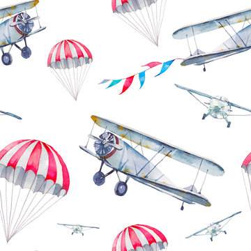 Watercolor cartoon air plane seamless pattern. Hand painted texture with vintage flying transportation, flags garland and parachute on white background. Repeating festive skydiving wallpaper design