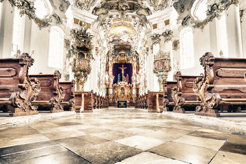 WIESKIRCHE, GERMANY – MARCH 07: View on rococo interior of chapel with benches on March 07, 2016 in Wieskirche, Germany.