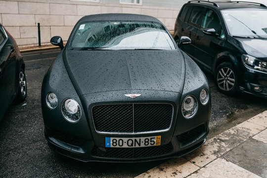 Lisbon, June 18, 2018: The modern luxury prestigious business car Bentley Continental is parked on a city street in rainy weather.