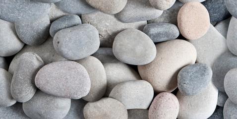 fondo horizontal de piedras redondeadas de la playa o rio