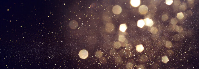 background of abstract glitter lights. gold and black. de focused. banner Fotobehang