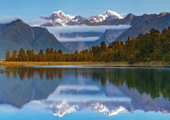 Scenic view of Lake Matheson near the Fox Glacier with reflected views of Aoraki Mount Cook and...