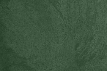 Dark green Concrete textured background to your concept or product. Winter 2020 color trend.