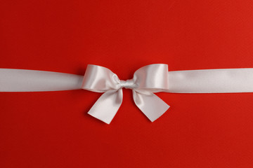 Wall Mural - White gift bow on red