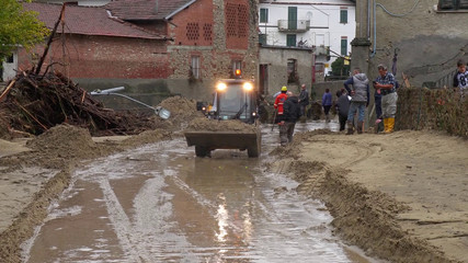 Local residents clean up after flash floods in Castelletto D'Orba
