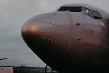 the nose of a passenger plane before flying at the airport
