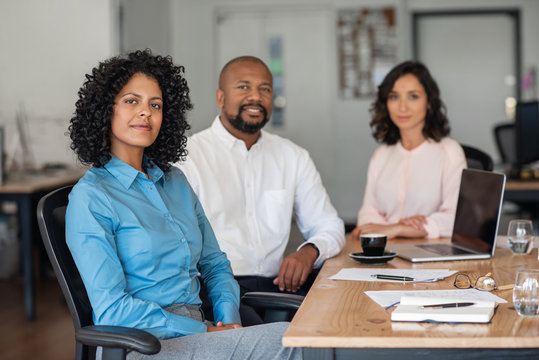 Diverse businesspeople working together at an office table