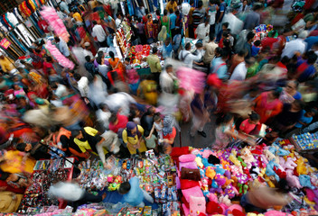 Shoppers crowd at a market place ahead of Diwali in Ahmedabad
