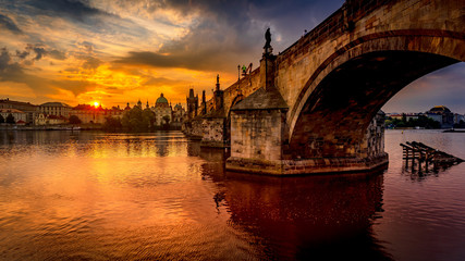 Acrylic Prints Prague Charles bridge (Karluv most) at sunrise, scenic view of the Old town with Old Town Bridge Tower, colorful sky and historic medieval architecture, Prague, Czech Republic. Holidays in Prague