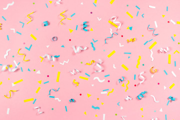 Colorful paper confetti exploding on pastel pink background Fototapete