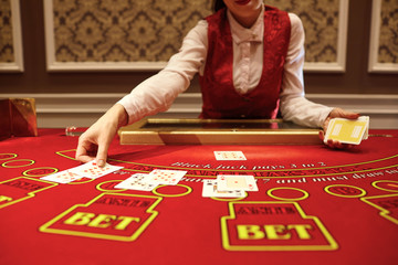 The croupier in the casino does a shuffle of cards
