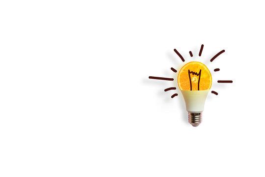 Creative conceptof a luminous energy-saving light bulb on white background. Energy conservation or idea concept.