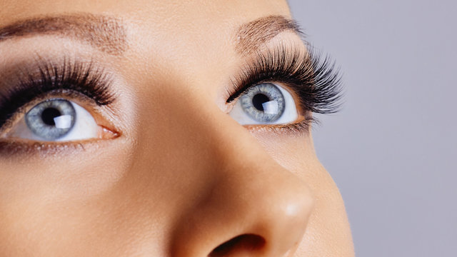 Woman eyes with long eyelashes and smokey eyes make-up. Eyelash extensions, makeup, cosmetics, beauty