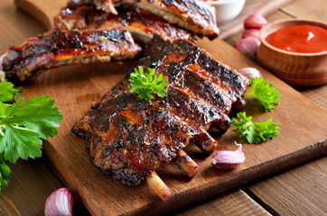 Spicy hot grilled spare ribs on cutting board