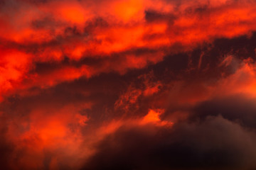 Foto auf Acrylglas Kastanienbraun Dramatic sunset sky over Font Romeu, situated in the Pyrenees mountains, France