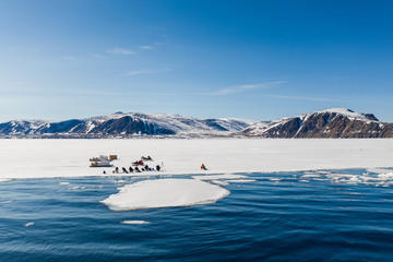 Tourists visit the floe edge near Sirmilik National Park in Nunavut, Canada