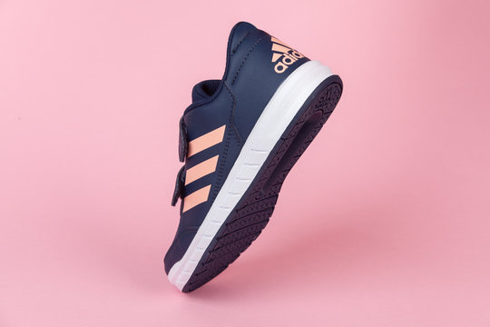 Varna , Bulgaria - AUGUST 13, 2019 : ADIDAS ALTA SPORT  shoe, on pink background. Product shot. Adidas is a German corporation that designs and manufactures sports shoes, clothing and accessories