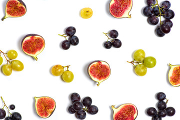 Figs and grapes on white background