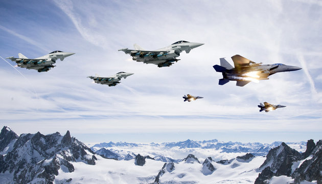 fighter planes flying in high altitude clouds