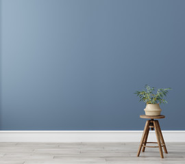 Chair with plant in empty living room interior, blue wall mock up background, 3D render