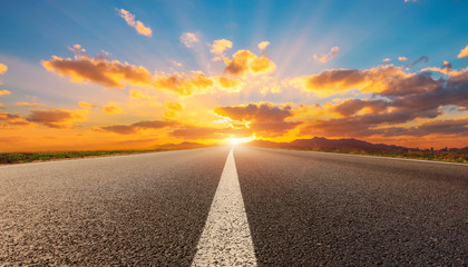 Wall Murals Deep brown empty road with sunrise and sunset background