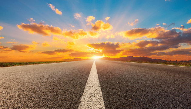 empty road with sunrise and sunset background