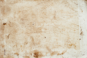 Aging, worn paper with water stains and rough edges