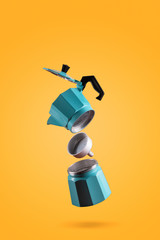 Parts of blue Italian retro coffee maker isolated on orange background. Freeze Motion photo